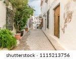 a narrow  quiet stone street in ... | Shutterstock . vector #1115213756