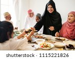 muslim woman sharing food at... | Shutterstock . vector #1115221826