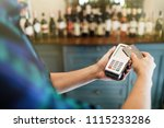 hand of customer paying with... | Shutterstock . vector #1115233286