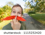 funny boy with a fake mustache... | Shutterstock . vector #1115252420