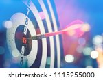 Stock photo close up shot of the dart arrow hit on bull eyes of dartboard to represent that the business 1115255000