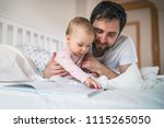 father with toddler girl... | Shutterstock . vector #1115265050