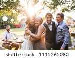 bride  groom with parents... | Shutterstock . vector #1115265080