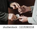 hand of addict man with money... | Shutterstock . vector #1115283218