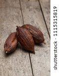 cocoa pod on a dark rustic... | Shutterstock . vector #1115315819