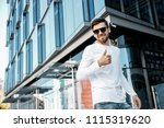 a young man travels through the ... | Shutterstock . vector #1115319620