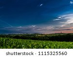 sunrise over a cornfield and a... | Shutterstock . vector #1115325560
