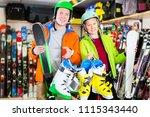 Happy customers are satisfied of their choice of ski and boots for skiing in sport shop - stock photo