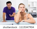 frustrated girl sitting at home ... | Shutterstock . vector #1115347904