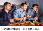 three men watching matchup on...   Shutterstock . vector #1115350568