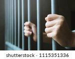 Man In Prison Hands Of Behind...
