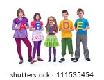 Young school children standing in row holding ABC letters - isolated with a bit of shadow - stock photo