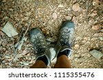 mens trekking shoes while... | Shutterstock . vector #1115355476