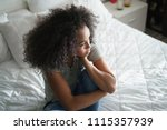 lonely young latina woman... | Shutterstock . vector #1115357939