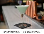 green cocktail with white cocoa ... | Shutterstock . vector #1115369933
