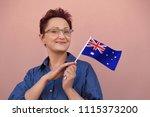 woman holding australian flag.... | Shutterstock . vector #1115373200