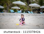 happy cute little girl playing... | Shutterstock . vector #1115378426