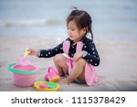 happy cute little girl playing... | Shutterstock . vector #1115378429