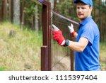 worker installing welded metal... | Shutterstock . vector #1115397404