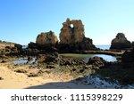 algarve coast near albufeira... | Shutterstock . vector #1115398229