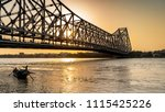 silhouette of howrah bridge at... | Shutterstock . vector #1115425226