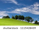 Hilly landscape with trrees near the Austria village Annaberg im Lammertal