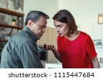 in despair. mature caring... | Shutterstock . vector #1115447684