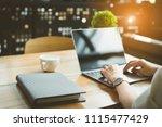 closeup hands of freelancer... | Shutterstock . vector #1115477429