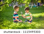 two adorable kid boy making... | Shutterstock . vector #1115495303