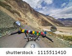 Small photo of Motorcycling the Leh Manali Highway, a high altitude road that traverses the great Himalayan range, Ladakh, India. View from the rider side