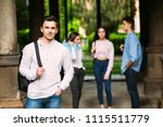 smiling student in front of a... | Shutterstock . vector #1115511779