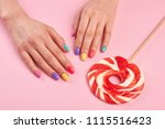 female polished nails and... | Shutterstock . vector #1115516423