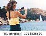 hipster blogger girl holds... | Shutterstock . vector #1115536610