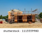 a new house is being built  a... | Shutterstock . vector #1115559980