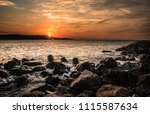 dramatic sunset on the sea with ... | Shutterstock . vector #1115587634