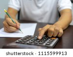 using calculators or manual... | Shutterstock . vector #1115599913