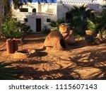 Small photo of Beni Abbes, Bechar, Algeria - November 1, 2017: In the garden of Grand Erg Hotel.