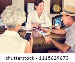receptionist giving... | Shutterstock . vector #1115629673