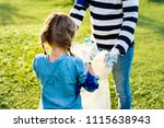 kids picking up trash in the... | Shutterstock . vector #1115638943