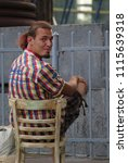 a young man in a checkered... | Shutterstock . vector #1115639318