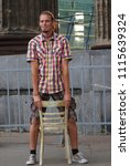 a young man in a checkered... | Shutterstock . vector #1115639324