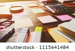 notes paper and supplies on...   Shutterstock . vector #1115641484