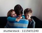 sad little boy and girl hugging ... | Shutterstock . vector #1115651240