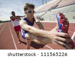 male athletes stretching on...   Shutterstock . vector #111565226