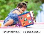 cute asian baby girl playing... | Shutterstock . vector #1115653550