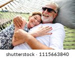 lovely mature couple on... | Shutterstock . vector #1115663840