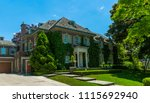luxury house in the suburbs of... | Shutterstock . vector #1115692940