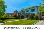 luxury house in the suburbs of... | Shutterstock . vector #1115692973