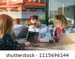 business team sitting on sunny... | Shutterstock . vector #1115696144