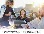 smiling freelancers working... | Shutterstock . vector #1115696180